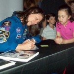 Photo of astronaut Tracy Caldwell Dyson signing autographs for schoolchildren April 18 at Fernbank Science Center.