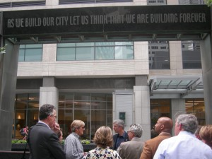 """Engraved in stone at key downtown plaza: """"As we build our city let us think that we are building forever."""" Preservation Houston's Parsons tells us that ironically the block used to have historic theaters and a hotel, some replaced by garages (Photo:  Maria Saporta)"""