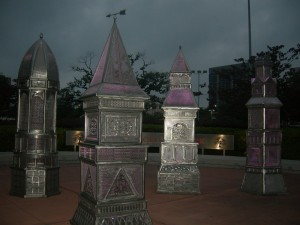Artistic metal replicas of Victorian houses that used to stand in downtown Houston now adorn public space near Toyota Arena (Photo: Maria Saporta)
