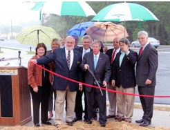Sen. Johnny Isakson (with scissors) cuts the ceremonial ribbon for the Johnson Ferry Road project. Credit: City of Sandy Springs