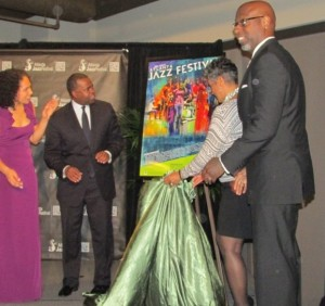 Atlanta Mayor Kasim Reed and Alexandra Jackson (both left) respond to the unveiling of the poster for the 2013 Atlanta Jazz Festival. Credit: rollingout.com