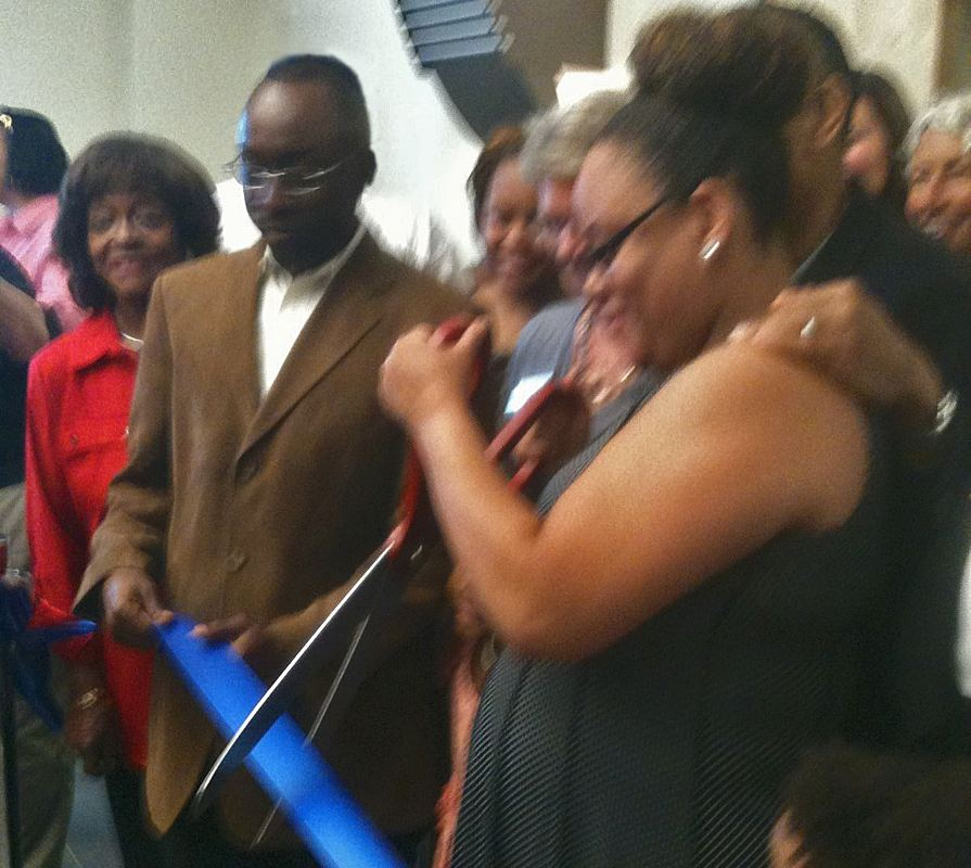 Photo of Brandy Brown Rhodes cutting the ribbon dedicating the Derwin Brown Police Precinct on June 28.