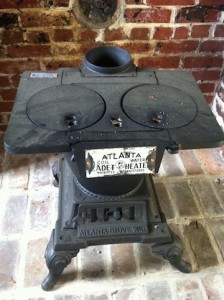 Photo of antique Atlanta cast iron stove smiley
