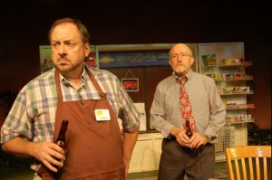 Photo of Charlie, a local grocer (played by William S. Murphey), and Malcolm (Tom Thon), who part ways over the mayor's efforts to placate anti-refugee residents. Sidington, is a fictional recreation of Clarkston and the play recounts actual events in the metro Atlanta hamlet. Credit: Third Country, 2013, Horizon Theatre Company.
