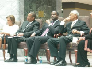 C.T, Vivian listens as Mayor Kasim Reed looks over the crowd (Photos: Maria Saporta)