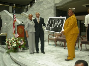 Elisabeth Omilami presents photo of a younger C.T. Vivian with Andrew Young and her father, Hosea Williams