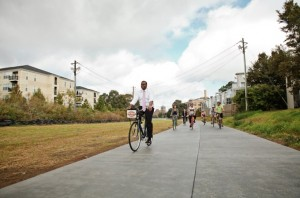 Mayor Kasim Reed said the BeltLine's planned transit system will require a public private partnership. Here he rides a bike at the dedication of the BeltLine's East Side Trail. Credit: Christopher T. Martin