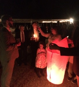 Bride and groom, Chelsea and Bobby Losh Jones, toast the pending launch of their wish balloon. Credit: David Pendered
