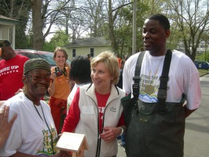 Resident Juanita Wallace, Blank Foundation's Penny McPhee and activist Tony Torrence talk during the Volunteer Day