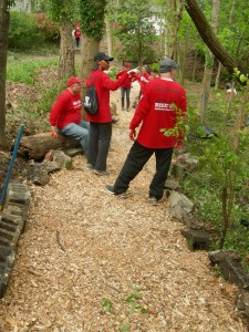 Volunteers look over a trail they have built through Lindsay Street Park