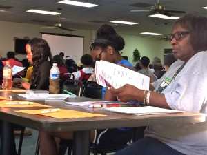 The conveners of the Aug. 14 forum to discuss Fort McPherson's redevelopment provided for volunteers to distribute materials. Credit: Donita Pendered
