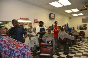 The barbers in this shop at Mall West End are so sought after that two dozen patrons waited their turn in a chair. Credit: Donita Pendered
