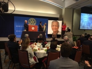 Unveiling of Muhammad Yunus portrait at Rotary Club of Atlanta. Portrait by Rotarian Ross Rossin
