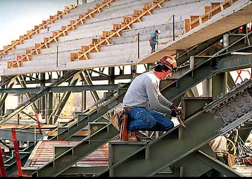 Jack Falls at work on the Olympic Stadium (AJC photo by Joey Ivansco)