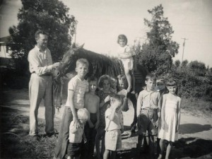 Clarence Jordan, the cofounder of Koinonia Farm, poses with the children of community members. Credit: Hargrett Rare Book and Manuscript Library, University of Georgia Libraries