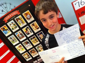 Cole Deschenes-Worboy, 11, with his Negro Leagues school project and letter from Seattle Mariners manager Lloyd McClendon