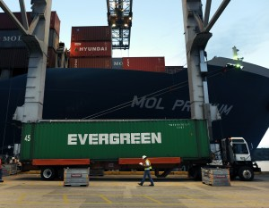 Cranes lift containers off ships and set them on trailers which will take them to a holding area. Credit: GPA