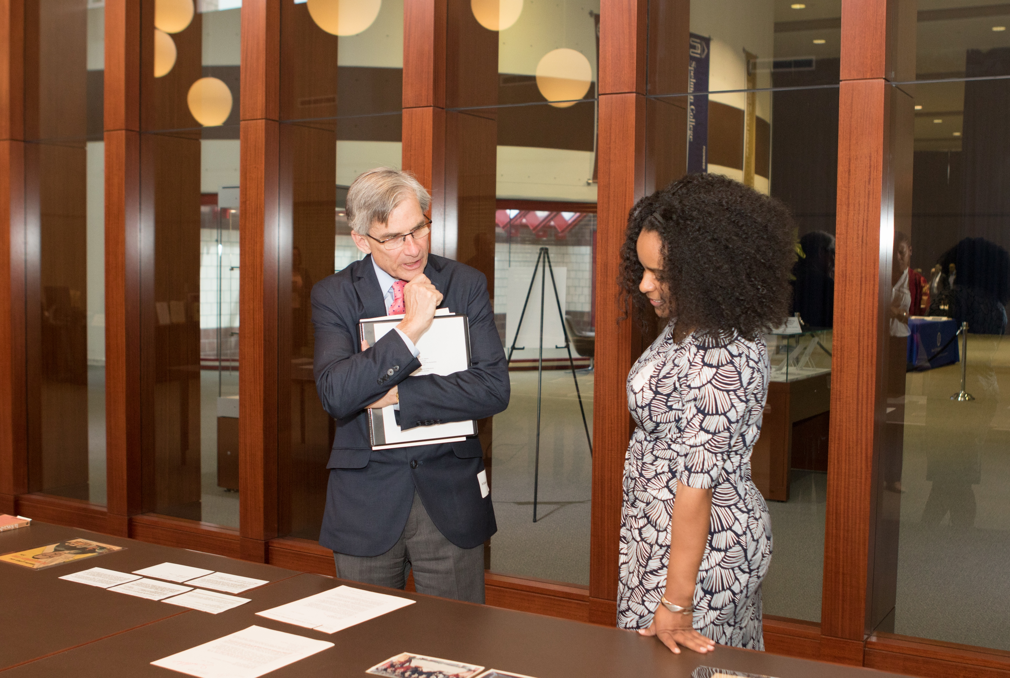NEH chairman William Adams with Andrea Jackson, head of the AUC Woodruff Library Archives Research Center, discussing items from the King Papers collection. Credit: courtesy of Atlanta University Center Robert Woodruff Library