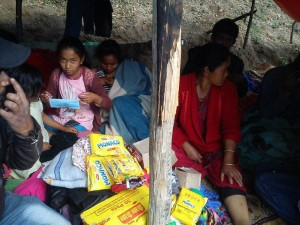 These Nepalese earthquake survivors received food provided by health care workers affiliated with Clarkston-based 50Cents.Period. Credit: Sunny Mir