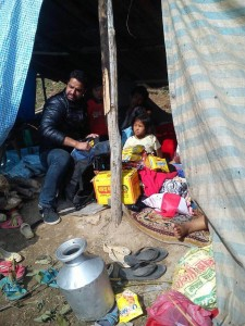 Nepalese earthquake refugees take shelter in a makeshift tent with food provided by health care workers affiliated with 50Cents.Period. Credit: Sunny Mir