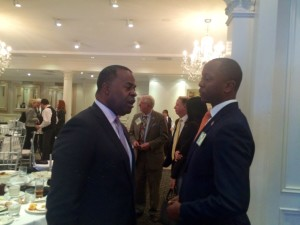 Atlanta Mayor Kasim Reed and APS Board Chair Courtney English huddle at the Buckhead Coalition luncheon on Wednesday (Photo by Maria Saporta)