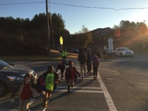Crossing guards halt traffic as students as they walk to and from Charles R. Drew Charter School. Credit: The Georgia Conservancy