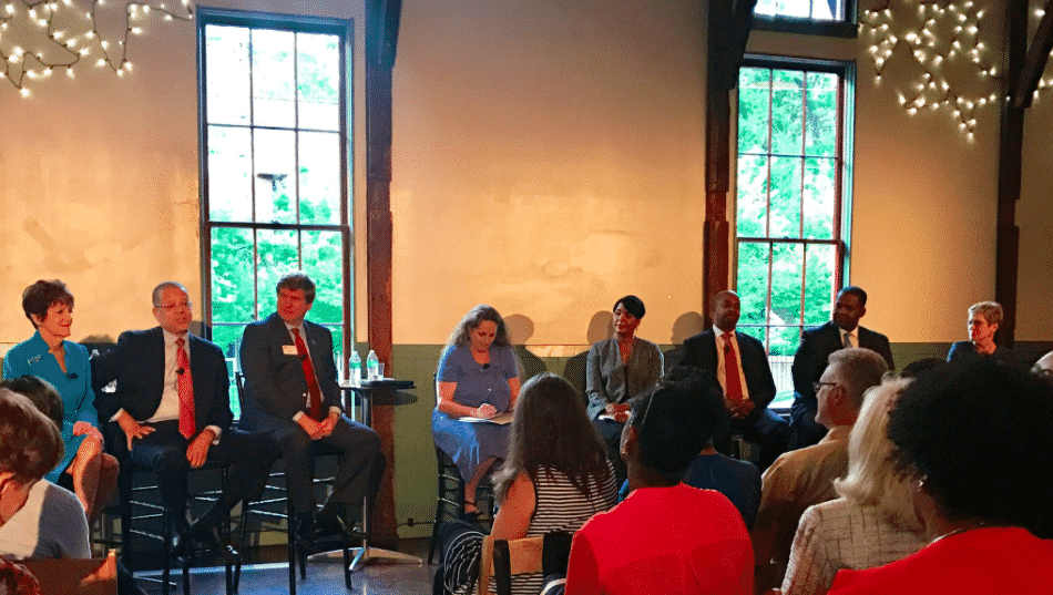 Maria Saporta with several of the candidates for Mayor of Atlanta. The event was held in the historic Trolley Barn in Inman Park.
