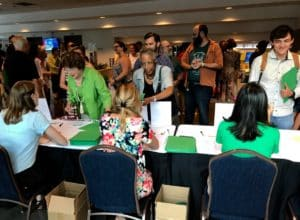 Audience members line up for sign-in and name tags ahead of an Atlanta mayoral candidates forum. Credit: Kelly Jordan