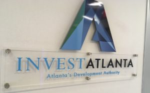 A photo of the Invest Atlanta logo on a wall