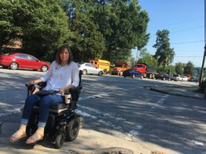 Karen DeVault crosses a poorly-marked crosswalk in Buckhead. She said the city needs to get its act together on sidewalks. Credit: Maggie Lee