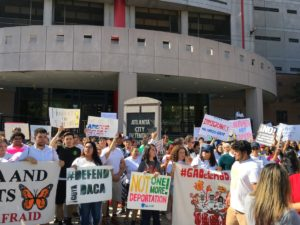 Marchers rally in favor of DACA front of Atlanta's city jail — where some folks are held on immigration charges. Credit: Maggie Lee