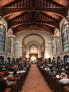 A few hundred folks filled St. Luke's Episcopal Church on Wednesday to hear mayoral candidates discuss their ideas on housing affordability. Credit: Kelly Jordan
