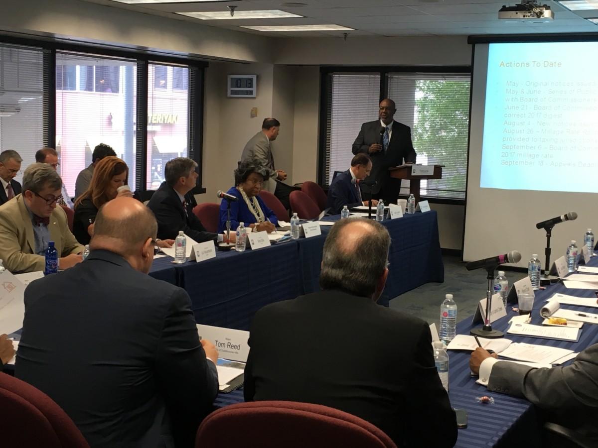 Mayors and other local leaders from Fulton County on Thursday discussed the idea asking the state Legislature for a cap on property tax rises. Credit: Maggie Lee