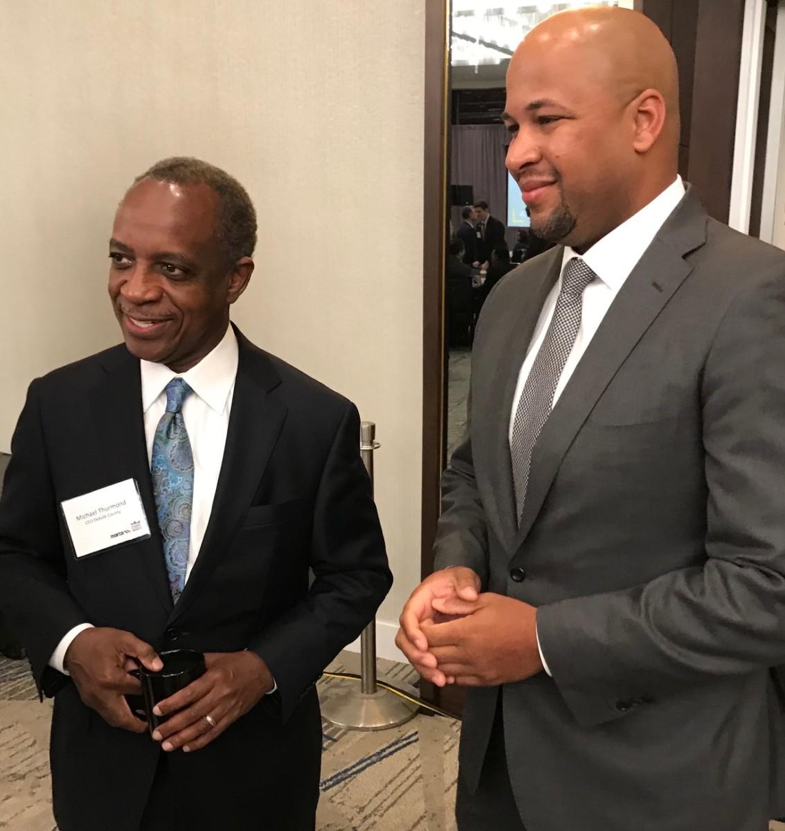 DeKalb County CEO Michael Thurmond (left) and political strategist Tharon Johnson at the State of MARTA breakfast. Credit: Kelly Jordan