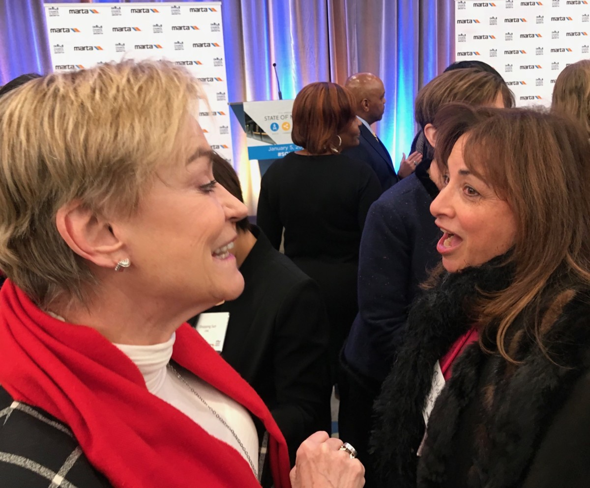 Atlanta Chamber of Commerce President and CEO Hala Moddelmog (left) chats at the State of MARTA breakfast. Credit: Kelly Jordan