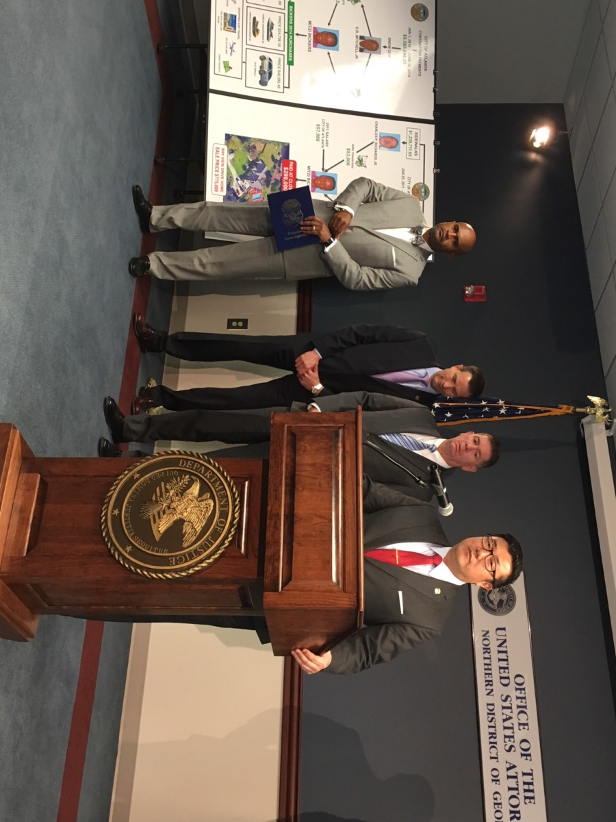 U.S. Attorney B.J. Pak, pictured with federal investigators at a Thursday press conference at the Richard B. Russell federal courthouse. Pak called on any person who took anything of value from Mitzi Bickers to cooperate with law enforcement. Credit: Maggie Lee
