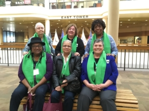 Members of The Oaks Resident Advocacy Group, pictured in a state office building en route to the Capitol on Wednesday. They're among the few hundred folks who have come to the state Capitol in Atlanta to advocate for seniors this year. Credit: Maggie Lee