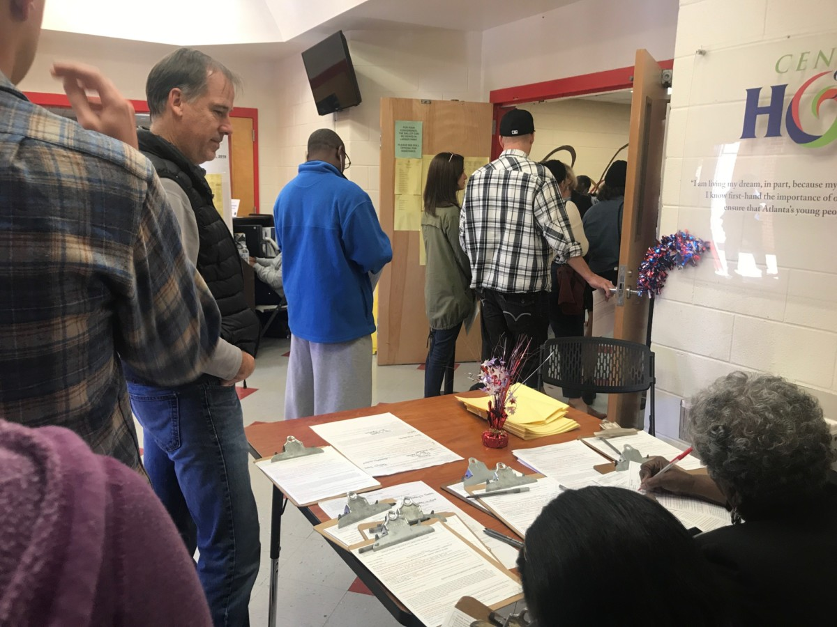 Poll workers and folks waiting to vote at DeKalb's Bessie Branham Recreation Center, Nov. 6, 2018. Credit: Britton Edwards