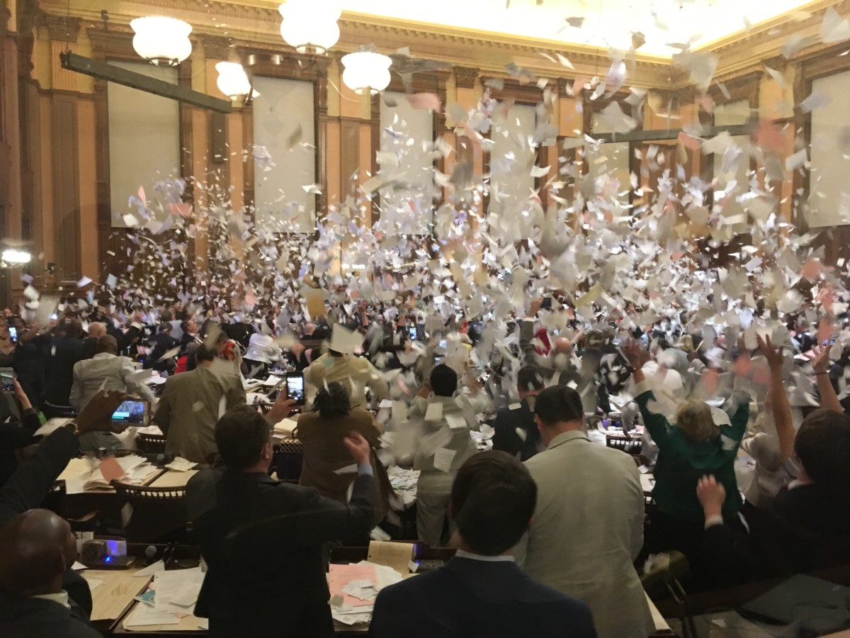 After voting on the medical cannabis cultivation bill, the House gave itself a standing ovation — then about 15 minutes later, they threw shredded paper in the air and joyously adjourned for the year. Credit: Maggie Lee