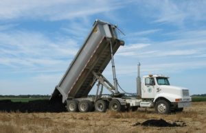 A typical application: a truck delivering biosolids to a field of stubble. Credit: City of Geneva/CC BY-NC 2.0