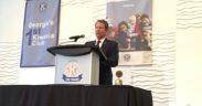 Brian Kemp at a podium at Kiwanis meeting