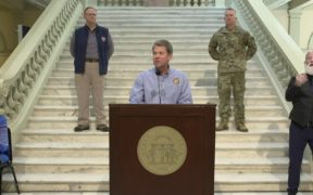 Brian Kemp at a podum