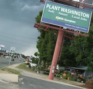 "A billboard reads ""Plant Washington: Safe Smart Local Jobs"""