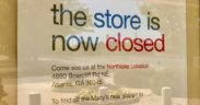 "Sign in South DeKalb Macy's window reading ""the store is now closed..."""