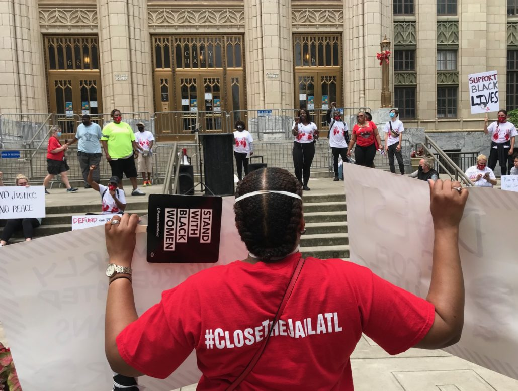 June 9 rally on Atlanta City Hall steps — protestors put pressure on the city to make good on its promise to close the jail. Credit: Kelly Jordan