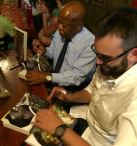 Congressman John Lewis with Andrew Ayden, co-authors of March: Book One, at Manuels Tavern in 2016. Credit: Kelly Jordan