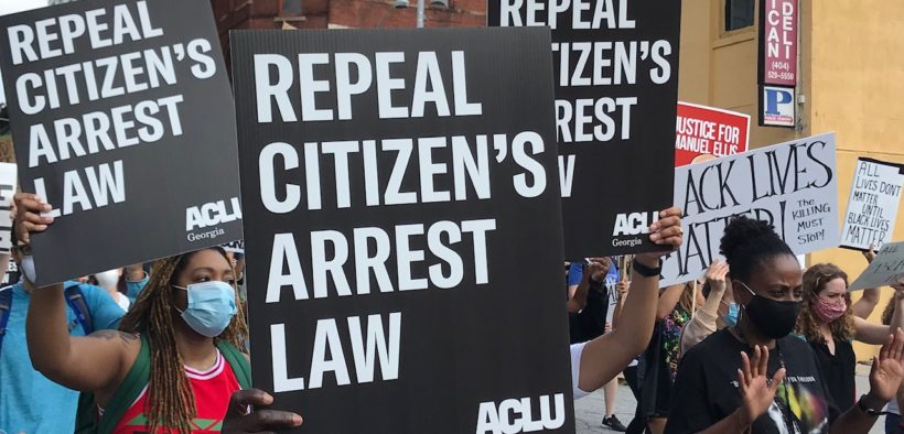 """Marchers in Atlanta carry signs reading """"Repeal Citizen's Arrest Law"""""""