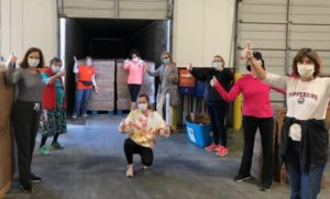 Fernandez, Action Ministries team food drive