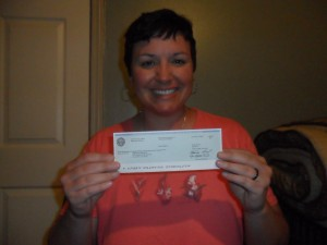 Christal Presley with her water overpayment check from the city of Atlanta.