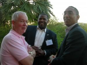 Tony Landers, coordinator of LINK trip, talks to Atlanta City Council President Ceasar Mitchell and DeKalb CEO Burrell Ellis during reception